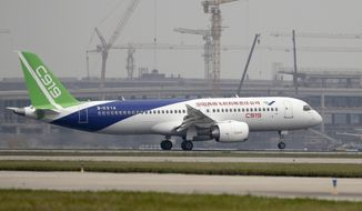 FILE - -In this Friday, May 5, 2017, file photo, a Chinese C919 passenger jet takes off on its first flight at Pudong International Airport in Shanghai. China's homegrown C919 passenger jet has touched down safely after its first long-haul test flight, bringing the nation one step closer to competing directly with aircraft giants in Europe and America. (AP Photo/Andy Wong, Pool)