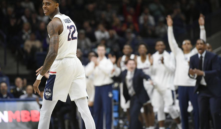 Connecticut's Terry Larrier reacts after scoring a three-point basket during the first half of an NCAA college basketball game against Colgate, Friday, Nov. 10, 2017, in Storrs, Conn. (AP Photo/Jessica Hill)