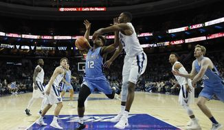 Columbia's Mike Smith, left, is fouled by Villanova's Mikal Bridges during the first half of an NCAA college basketball game, Friday, Nov. 10, 2017, in Philadelphia. (AP Photo/Matt Slocum)