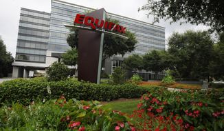 This Saturday, July 21, 2012, photo shows the headquarters of Equifax Inc., in Atlanta. Equifax expects the financial impact from a massive data breach earlier in 2017 to linger and weigh down fourth-quarter results. (AP Photo/Mike Stewart)