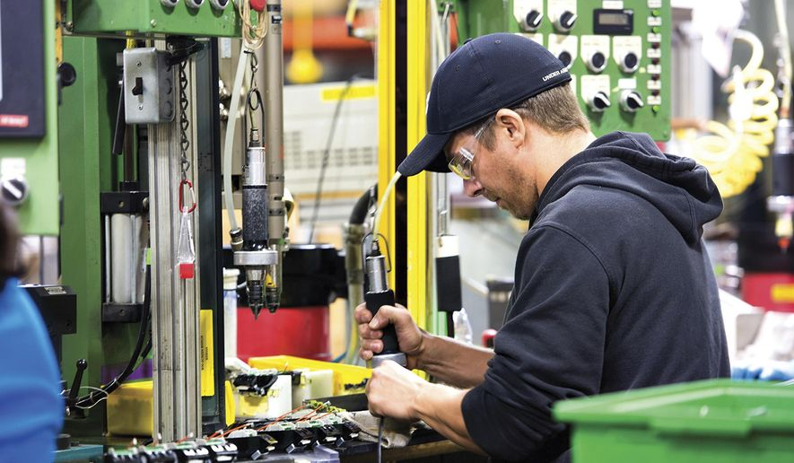 In this Oct. 30, 2017 photo, Wahl Clipper assemblers work on the assembly line that  manufactures the companies signature clipper in Sterling, Ill. Wahl Clipper has more than 1,000 workers in Sterling, and it attributes about 100 jobs to its longtime partnership with Walmart. While navigating turbulent economic cycles, Wahl Clipper hasn't laid off a worker in about 50 years, a source of great pride for CEO and President Greg Wahl. (Alex T. Paschal/Sauk Valley Media via AP)