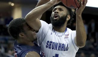 Seton Hall guard Eron Gordon (4) goes up for a shot against Fairleigh Dickinson forward Dondre Rhoden (20) during the second half of an NCAA college basketball game, Friday, Nov. 10, 2017, in Newark, N.J. Seton Hall won 90-68. (AP Photo/Julio Cortez)