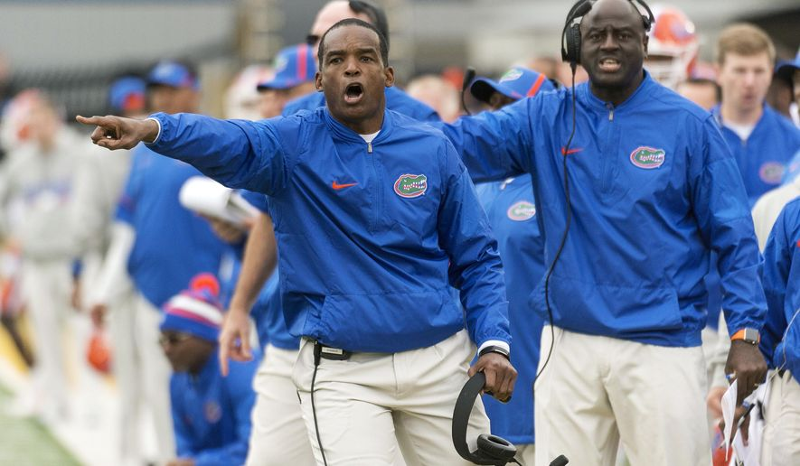 Florida head coach Randy Shannon argues a call with a referee during the first half of an NCAA college football game against Missouri Saturday, Nov. 4, 2017, in Columbia, Mo. Missouri won the game 45-16. (AP Photo/L.G. Patterson)