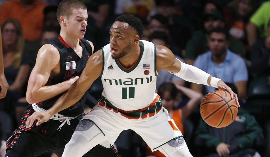 Miami guard Bruce Brown Jr. (11) drives up against Gardner Webb guard Liam O'Reilly during the first half of an NCAA college basketball game, Friday, Nov. 10, 2017, in Coral Gables, Fla. (AP Photo/Wilfredo Lee)