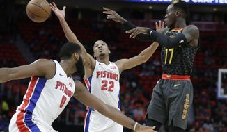 Atlanta Hawks guard Dennis Schroder (17) passes between Detroit Pistons center Andre Drummond (0) and guard Avery Bradley (22) durng the first half of an NBA basketball game, Friday, Nov. 10, 2017, in Detroit. (AP Photo/Carlos Osorio)