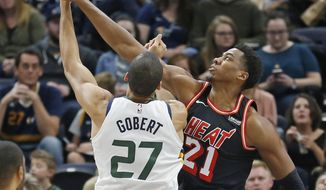 Miami Heat center Hassan Whiteside (21) defends against Utah Jazz center Rudy Gobert (27) in the first half during an NBA basketball game Friday, Nov. 10, 2017, in Salt Lake City. (AP Photo/Rick Bowmer)