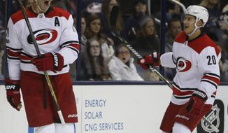Carolina Hurricanes' Jordan Staal, left, celebrates his goal against the Columbus Blue Jackets with teammate Sebastian Aho, of Finland, during the third period of an NHL hockey game Friday, Nov. 10, 2017, in Columbus, Ohio. The Hurricanes beat the Blue Jackets 3-1. (AP Photo/Jay LaPrete)