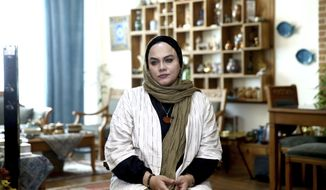 In this Saturday, Oct. 21, 2017, photo, Iranian film director Narges Abyar gives an interview to The Associated Press at her home, in Tehran, Iran. (AP Photo/Ebrahim Noroozi)