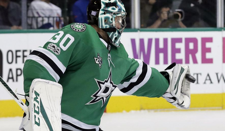 Dallas Stars goalie Ben Bishop (30) reaches out to glove a shot from the New York Islanders in the second period of an NHL hockey game, Friday, Nov. 10, 2017, in Dallas. (AP Photo/Tony Gutierrez)