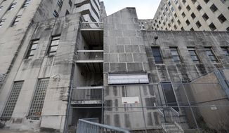 The shuttered Charity Hospital building is seen in downtown New Orleans, Thursday, Nov. 9, 2017. Urban planning experts are about to make public their recommendations for the future of New Orleans' sprawling Charity Hospital. The 20-story, million-square-foot art deco building never reopened after levee failures during Hurricane Katrina caused catastrophic flooding in 2005. (AP Photo/Gerald Herbert)