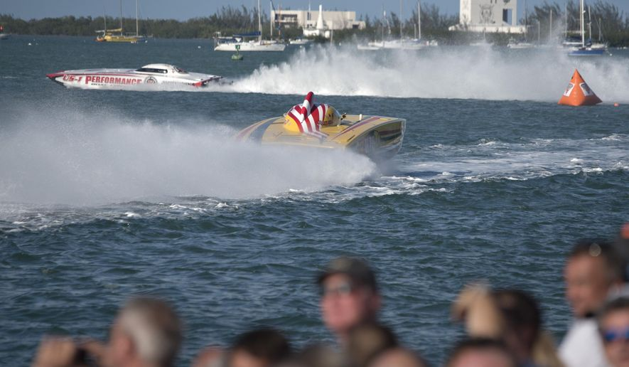 In this photo provided by the Florida Keys News Bureau, Performance Boat Center, left, throttled by John Tomlinson and driven by Myrick Coil, rounds checkpoint #3 trailed by WHM Motorsports with William Mauff and Jay Muller at the controls, during the second day of racing at the Key West World Championship Friday, Nov. 10, 2017, in Key West, Fla. Performance won the Superboat class Friday, but WHM has a narrow lead entering the final race set for Sunday, Nov. 12. (Rob O'Neal/Florida Keys News Bureau via AP)