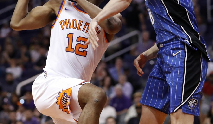 Phoenix Suns forward TJ Warren (12) drives against the Orlando Magic during the second half of an NBA basketball game, Friday, Nov. 10, 2017, in Phoenix. (AP Photo/Matt York)