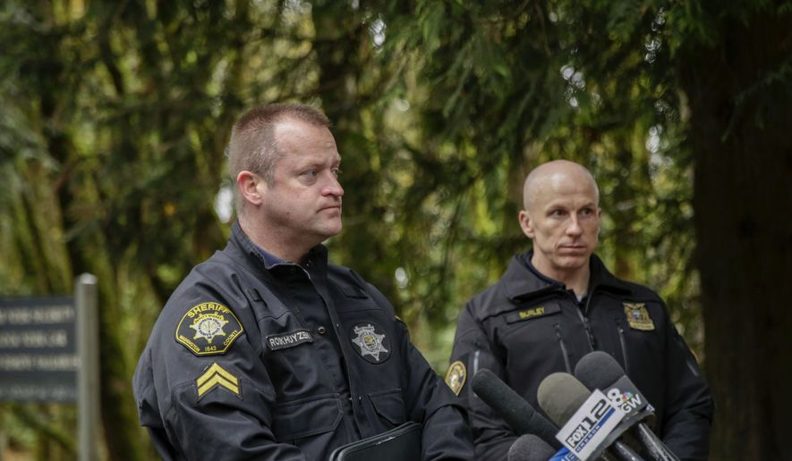 Portland Police spokesman Sgt. Chris Burleyr, right,  and Washington County Sheriff's Detective Robert Rookhuyzen speak to the media, Friday, Nov. 10, 2017, in Portland, Ore. Two bodies found in a forested park in Portland have been identified as a missing teenage girl and a man who was the subject of a sexual abuse investigation involving the teen, police said Friday. (Stephanie Yao Long /The Oregonian via AP)