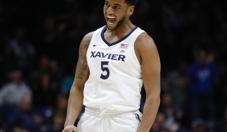 Xavier's Trevon Bluiett reacts after scoring in the first half of an NCAA college basketball game against Morehead State, Friday, Nov. 10, 2017, in Cincinnati. (AP Photo/John Minchillo)