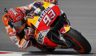 FILE - This is a Saturday, Oct. 28, 2017 file photo of Spain's MotoGP rider Marc Marquez as he steers his Honda during the third practice session of the Malaysia MotoGP at the Sepang International circuit in Sepang, Malaysia. Defending MotoGP champion Marc Marquez enters the season-concluding Valencia grand prix on Sunday Nov. 12, 2017, with only one challenger Andrea Dovizioso, possibly separating him from his sixth overall title. (AP Photo/Vincent Thian/File)