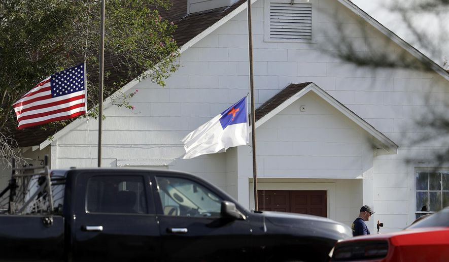 FILE - In this Nov. 7, 2017, file photo, flags fly at half-staff as law enforcement officials continue to investigate the scene of a shooting at the First Baptist Church of Sutherland Springs in Sutherland Springs, Texas. The AP reported on Nov. 10, 2017, that a story claiming a man who killed more than two dozen people at the church on Sunday was a member of an anti-fascist movement intent on causing a civil war was false. (AP Photo/Eric Gay, File)