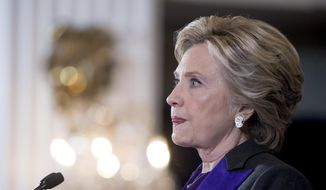 In this Nov. 9, 2016, file photo, Hillary Clinton pauses while delivering a speech conceding her defeat to Republican Donald Trump after the hard-fought presidential election. (AP Photo/Andrew Harnik, File)