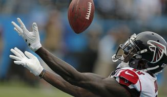 FILE - In this Nov. 5, 2017, file photo, Atlanta Falcons' Julio Jones (11) misses a touchdown catch against the Carolina Panthers in the second half of an NFL football game in Charlotte, N.C.  Jones dropped the touchdown pass on Sunday against the Panthers, but was surprised when Carolina safety Kurt Coleman came over to offer encouraging words to him. (AP Photo/Bob Leverone, File)