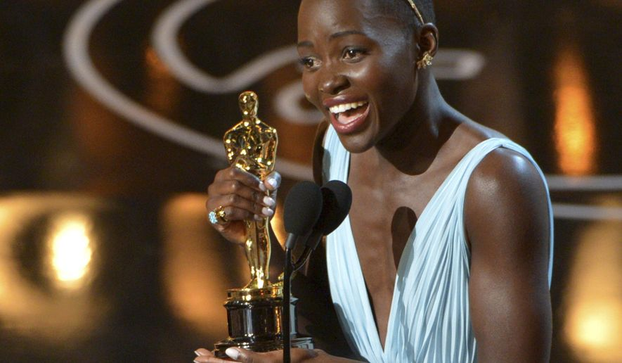 """FILE - In this Sunday, March 2, 2014 file photo, Lupita Nyong'o accepts the award for best actress in a supporting role for """"12 Years a Slave"""" during the Oscars at the Dolby Theatre in Los Angeles. British magazine Grazia U.K. on Friday Nov. 10, 2017, has apologized to Lupita Nyong'o after the actress accused it of altering her hair on its front cover """"to fit a more Eurocentric notion"""" of beauty. (Photo by John Shearer/Invision/AP, File)"""