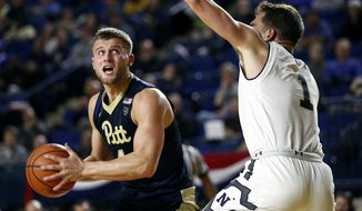 Pittsburgh forward Ryan Luther, left, looks for a shot against Navy forward Tom Lacey during the first half of an NCAA college basketball game at the Veterans Classic tournament in Annapolis, Md., Friday, Nov. 10, 2017. (AP Photo/Patrick Semansky)