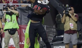 Seattle Seahawks tight end Jimmy Graham pulls in a touchdown pass as Arizona Cardinals strong safety Antoine Bethea (41) defends during the second half of an NFL football game, Thursday, Nov. 9, 2017, in Glendale, Ariz. (AP Photo/Rick Scuteri)