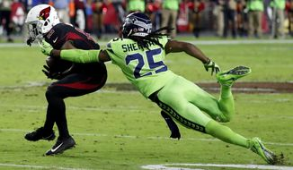 Seattle Seahawks cornerback Richard Sherman (25) tackles Arizona Cardinals wide receiver John Brown (12) during the second half of an NFL football game against the Arizona Cardinals, Thursday, Nov. 9, 2017, in Glendale, Ariz. Sherman walked to the bench after being injured on the play. (AP Photo/Rick Scuteri) ** FILE **