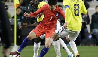 South Korea' Son Heung-min, second from right, fights for the ball against Colombia's and Davinson Sanchez and Abel Aguilar, right, during their friendly soccer match at Suwon World Cup Stadium in Suwon, South Korea, Friday, Nov. 10, 2017. (AP Photo/Ahn Young-joon)