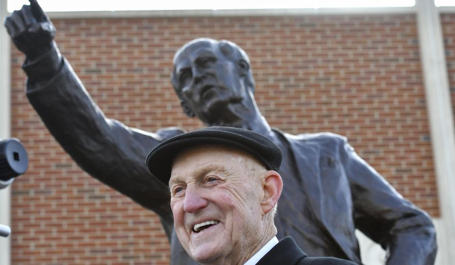 Former Missouri basketball head coach Norm Stewart after the unveiling of a statue in his honor in front of the Mizzou Arena Friday, Nov. 10, 2017, in Columbia, Mo.  (John Sleezer/The Kansas City Star via AP)