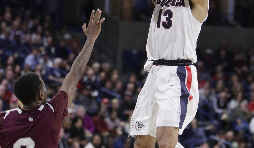 Gonzaga guard Josh Perkins (13) shoots against Texas Southern guard Demontrae Jefferson (3) during the second half of an NCAA college basketball game in Spokane, Wash., Friday, Nov. 10, 2017.  (AP Photo/Young Kwak)