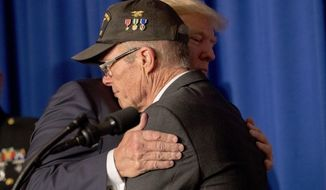 U.S. President Donald Trump hugs Vietnam veteran Max Morgan of Santa Clarita, Calif., as he becomes emotional while speaking at a veterans event at the Grand Hyatt, Friday, Nov. 10, 2017, in Danang, Vietnam. Trump is on a five-country trip through Asia traveling to Japan, South Korea, China, Vietnam and the Philippines. (AP Photo/Andrew Harnik)
