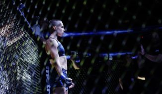 Rose Namajunas is announced before fighting Joanna Jedrzejczyk, of Poland, in a women's strawweight title mixed martial arts bout at UFC 217 Saturday, Nov. 4, 2017, in New York. Namajunas won the fight. (AP Photo/Frank Franklin II)