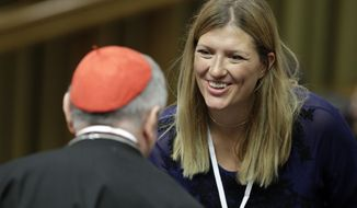 Executive Director of the International Campaign to Abolish Nuclear Weapons Beatrice Fihn, right, talks with Vatican Secretary of State Pietro Parolin on the occasion of a conference on nuclear disarmament, at the Vatican, Friday, Nov. 10, 2017. The Vatican hosted Nobel laureates, U.N. and NATO officials and a handful of nuclear powers at a conference aimed at galvanizing support for a global shift from the Cold War era policy of nuclear deterrence to one of total nuclear disarmament.(AP Photo/Andrew Medichini)