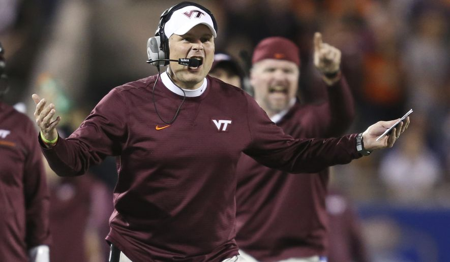 FILE - In this Dec. 3, 2016, file photo, Virginia Tech head coach Justin Fuente argues a call during the first half of the Atlantic Coast Conference championship NCAA college football game against Clemson, in Orlando, Fla. With Virginia Tech's biggest prize now out of reach, it would be easy to get discouraged. Justin Fuente doesn't want to hear that kind of talk. The Hokies coach insists there's still so much to play for. (AP Photo/Willie J. Allen Jr., File)