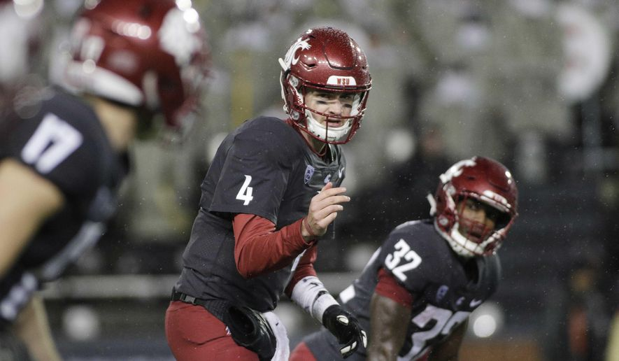 FILE - In this Oct. 21, 2017, file photo, Washington State quarterback Luke Falk (4) calls a play during the first half of the team's NCAA college football game against Colorado in Pullman, Wash. Washington State coach Mike Leach declined to call Saturday's matchup against Utah a do-or-die game in the quest to win the Pac-12 North and a berth in the league title game, but it basically is. (AP Photo/Young Kwak, File)