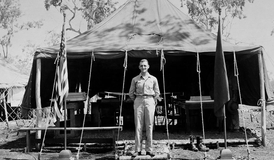 In this undated photo provided by the U.S. Air Force, Brig. Gen. Kenneth N. Walker, commanding general of a bomber command in the Southwest Pacific, poses for a photo in front of his tent-office in the field. Nearly 75 years after his father disappeared during a bombing mission over a remote Pacific island, Douglas Walker, the son of the highest-ranking recipient of the Medal of Honor still listed as missing from World War II, is pushing for renewed interest in finding the crash site and the remains of the crew. (AP Photo/USAF)