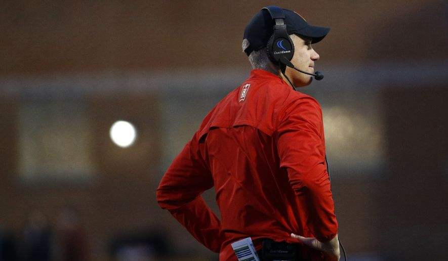 Maryland head coach DJ Durkin stands on the field in the first half of an NCAA college football game against Michigan in College Park, Md., Saturday, Nov. 11, 2017. (AP Photo/Patrick Semansky)