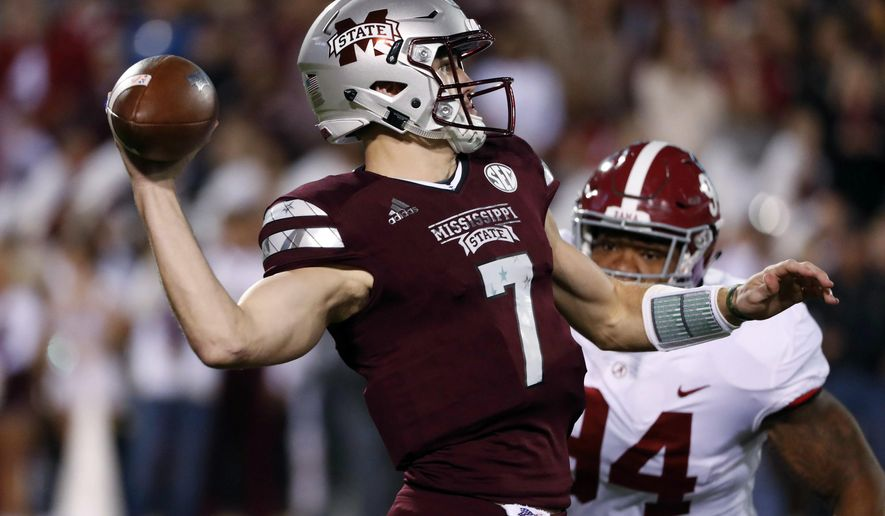 Mississippi State quarterback Nick Fitzgerald (7) throws as Alabama defensive lineman Da'Ron Payne (94) tries to tackle him during the first half of an NCAA college football game in Starkville, Miss., Saturday, Nov. 11, 2017. (AP Photo/Rogelio V. Solis)