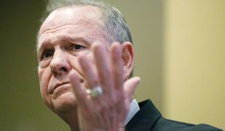 Former Alabama Chief Justice and U.S. Senate candidate Roy Moore speaks at the Vestavia Hills Public library, Saturday, Nov. 11, 2017, in Birmingham, Ala. According to a Thursday, Nov. 9 Washington Post story an Alabama woman said Moore made inappropriate advances and had sexual contact with her when she was 14. Moore has denied the allegations. (AP Photo/Brynn Anderson)