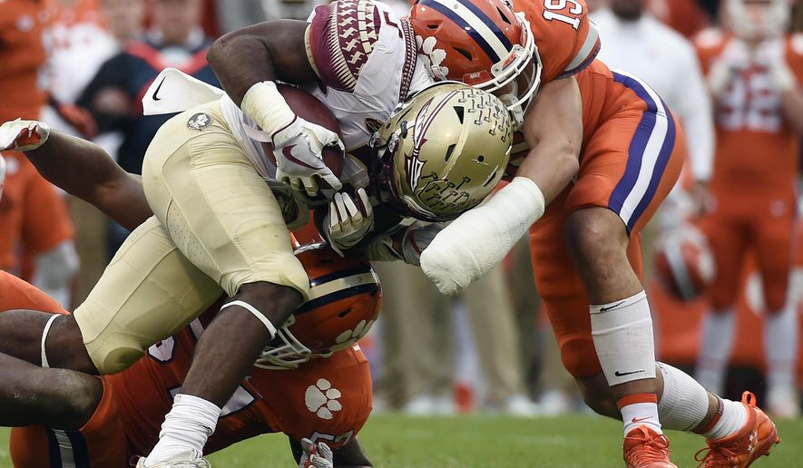 Florida State running back Cam Akers (3) is tackled by Clemson safety Tanner Muse (19) during the first half of an NCAA college football game, Saturday, Nov. 11, 2017, in Clemson, S.C. (AP Photo/Rainier Ehrhardt)