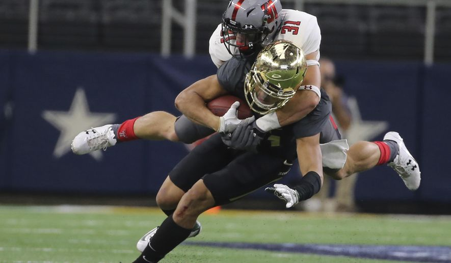Texas Tech defensive back Justus Parker (31) tackles Baylor wide receiver Tony Nicholson (13) in the first half of an NCAA college football game, Saturday, Nov. 11, 2017, in Arlington, Texas. (Jerry Larson/Waco Tribune Herald, via AP)
