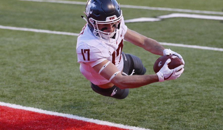 Washington State wide receiver Kyle Sweet (17) dives for a touchdown against Utah in the first half of an NCAA college football game, Saturday, Nov. 11, 2017, in Salt Lake City. (AP Photo/Rick Bowmer)