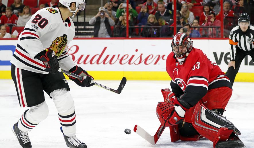 Chicago Blackhawks' Brandon Saad (20) fails on a penalty shot to get the puck past Carolina Hurricanes goalie Scott Darling (33) during the first period of an NHL hockey game, Saturday, Nov. 11, 2017, in Raleigh, N.C. (AP Photo/Karl B DeBlaker)