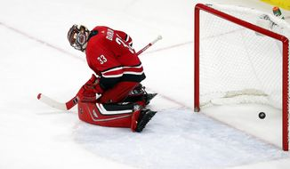 Chicago Blackhawks' Brandon Saad's shot goes through the legs of Carolina Hurricanes goalie Scott Darling (33) to win an NHL hockey game in overtime Saturday, Nov. 11, 2017, in Raleigh, N.C. (AP Photo/Karl B DeBlaker)