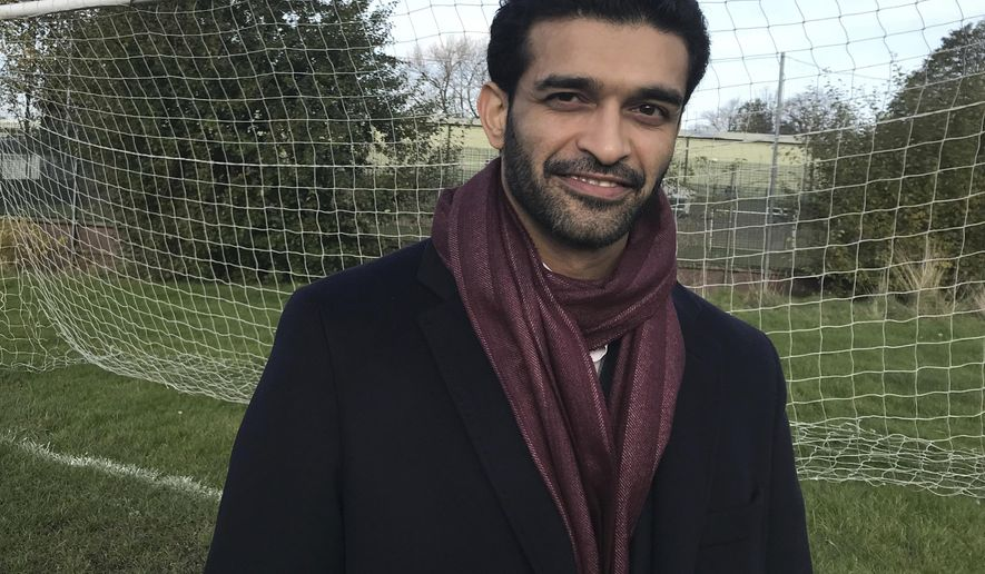 """Hassan Al Thawadi, secretary general of the 2022 Qatar World Cup Supreme Committee for Delivery & Legacy, poses for a photo following an interview with The Associated Press in Sheffield, England on Thursday Nov. 9 2017.  Following comments earlier this year attributed to German soccer federation president Reinhard Grindel, Al Thawadi said Thursday that """"Qatar does not support terrorism. Qatar is at the forefront of the fight against terrorism.""""  (AP Photo / Rob Harris)"""