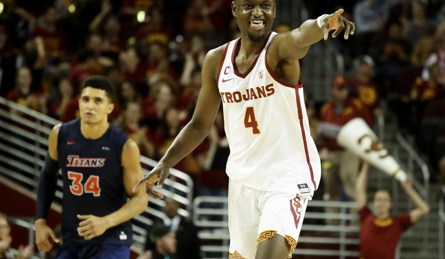 Southern California forward Chimezie Metu, right, celebrates after scoring against Cal State Fullerton during the first half of an NCAA college basketball game in Los Angeles, Friday, Nov. 10, 2017. (AP Photo/Chris Carlson)
