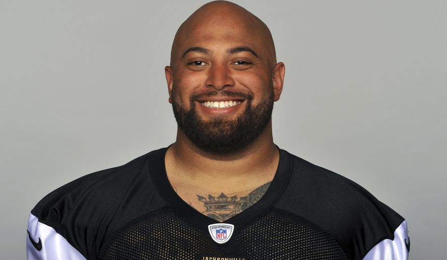 FILE - This is a 2014 photo of Roy Miller of the Jacksonville Jaguars NFL football team. Jail records show that Miller, who currently plays for the Kansas City Chiefs has been arrested Saturday, Nob. 11, 2017, in Florida on a domestic battery charge. Miller, 30, played for the Jaguars from 2013 to 2017, and the signed with the Chiefs. (AP Photo/File)