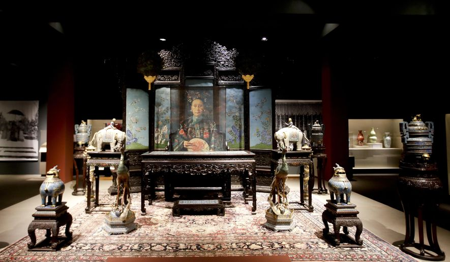 "The Reception Throne Set is shown in the exhibition ""Express Dowager, Cixi."" at Orange County's Bowers Museum, Thursday, Nov. 9, 2017, in Santa Ana, Calif. The exhibit focuses on Cixi, the mysterious woman who quietly ruled China with an iron fist from the mid-1800s until her death in 1908. (AP Photo/Chris Carlson)"