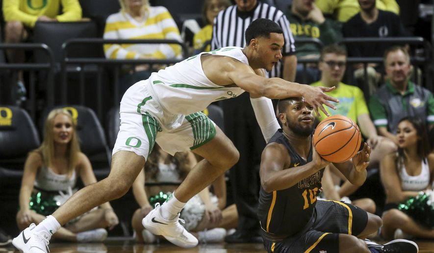 Oregon's Keith Smith knocks the ball loose from Coppin State's Karonn Davis during an NCAA college basketball game in Eugene, Ore., Friday, Nov. 10, 2017. (Collin Andrew/The Register-Guard via AP)
