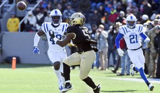 Army running back Kell Walker (5) makes a catch for 42 yards in front of Duke linebacker Koby Quansah (49) during the first half of an NCAA college football game on Saturday, Nov. 11, 2017, in West Point, N.Y. (AP Photo/Hans Pennink)