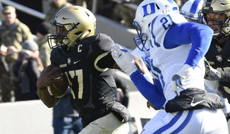 Army quarterback Ahmad Bradshaw (17) runs the ball for a touchdown past Duke safety Alonzo Saxton II (21) during the first half of an NCAA college football game on Saturday, Nov. 11, 2017, in West Point, N.Y. (AP Photo/Hans Pennink)